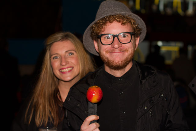 Kerry & Nick Share a traditional Sticky Toffee Apple outside Effra Social Club